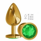 Большая золотая пробочка с изумрудным круглым кристаллом